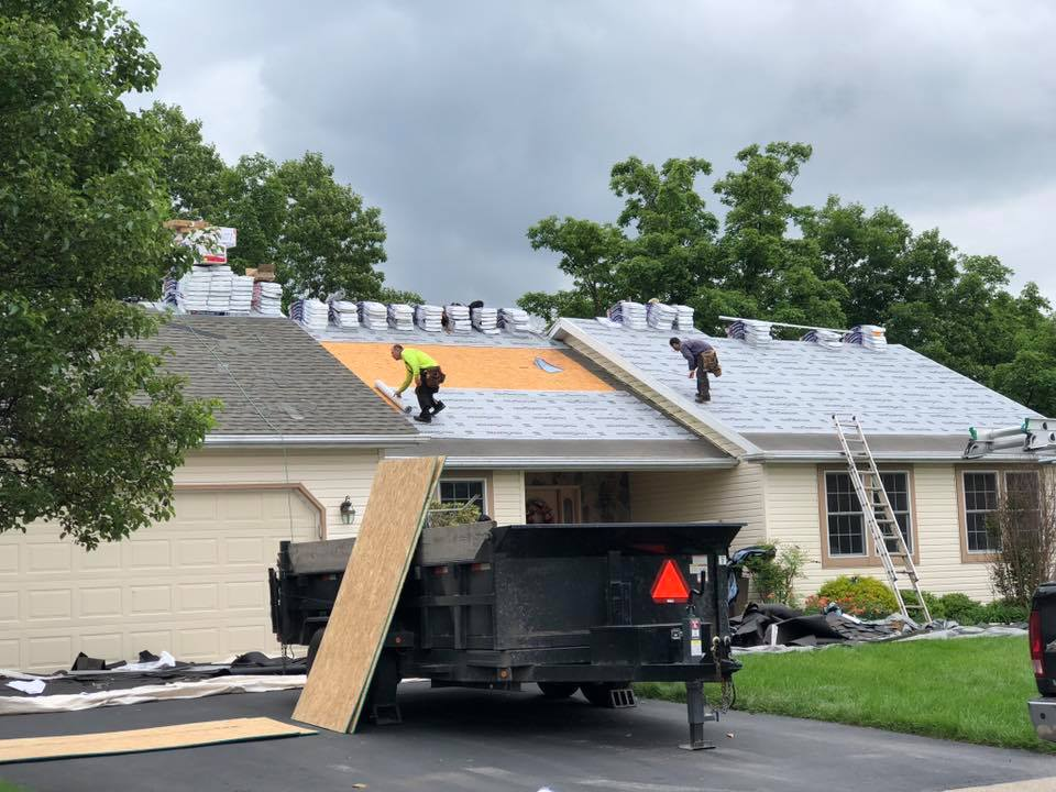 Mechanicsburg roof repair contactor working on residential home.